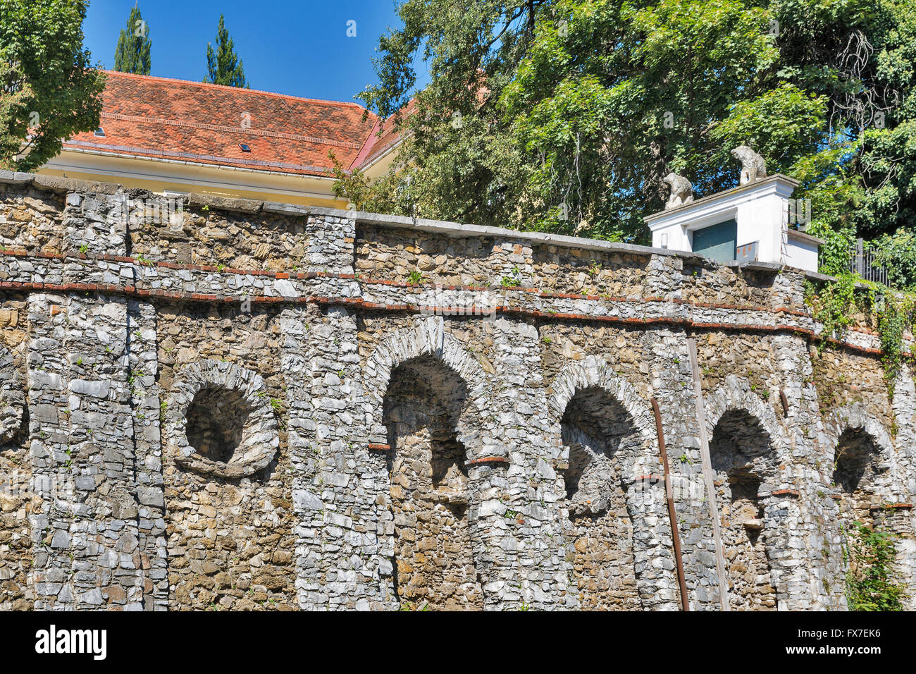 Ancient fortified stone wall close to Volkskunde museum in Graz, Austria - Stock Image