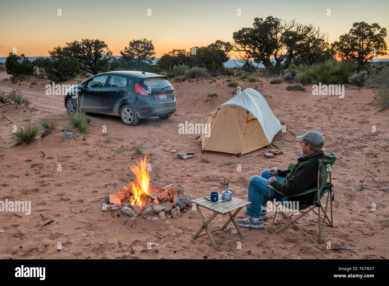 Camper at campsite at sunset near Muley Point on Cedar Mesa, Utah, USA - Stock Image