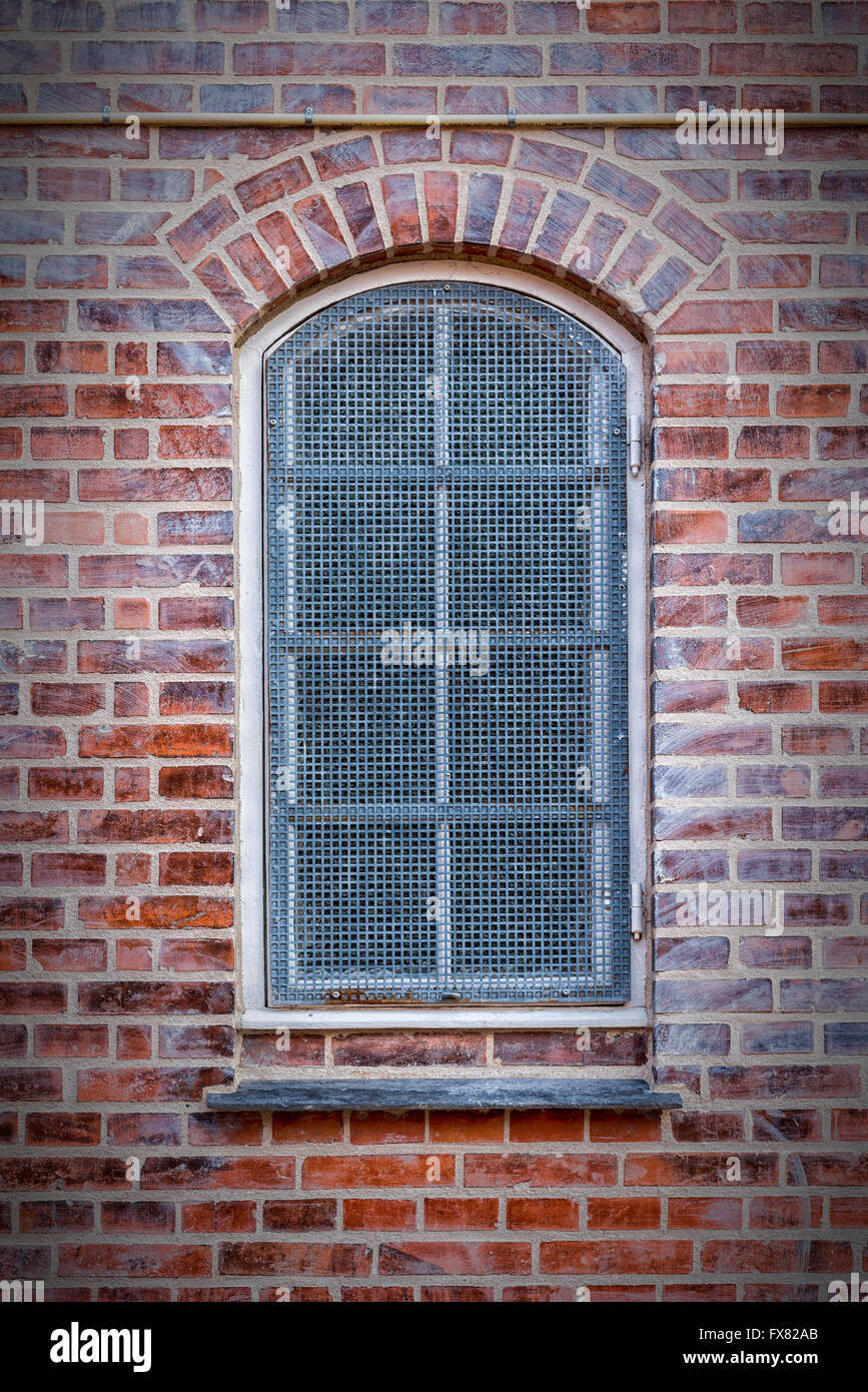A grilled window in the Danish town of Helsingor. - Stock Image