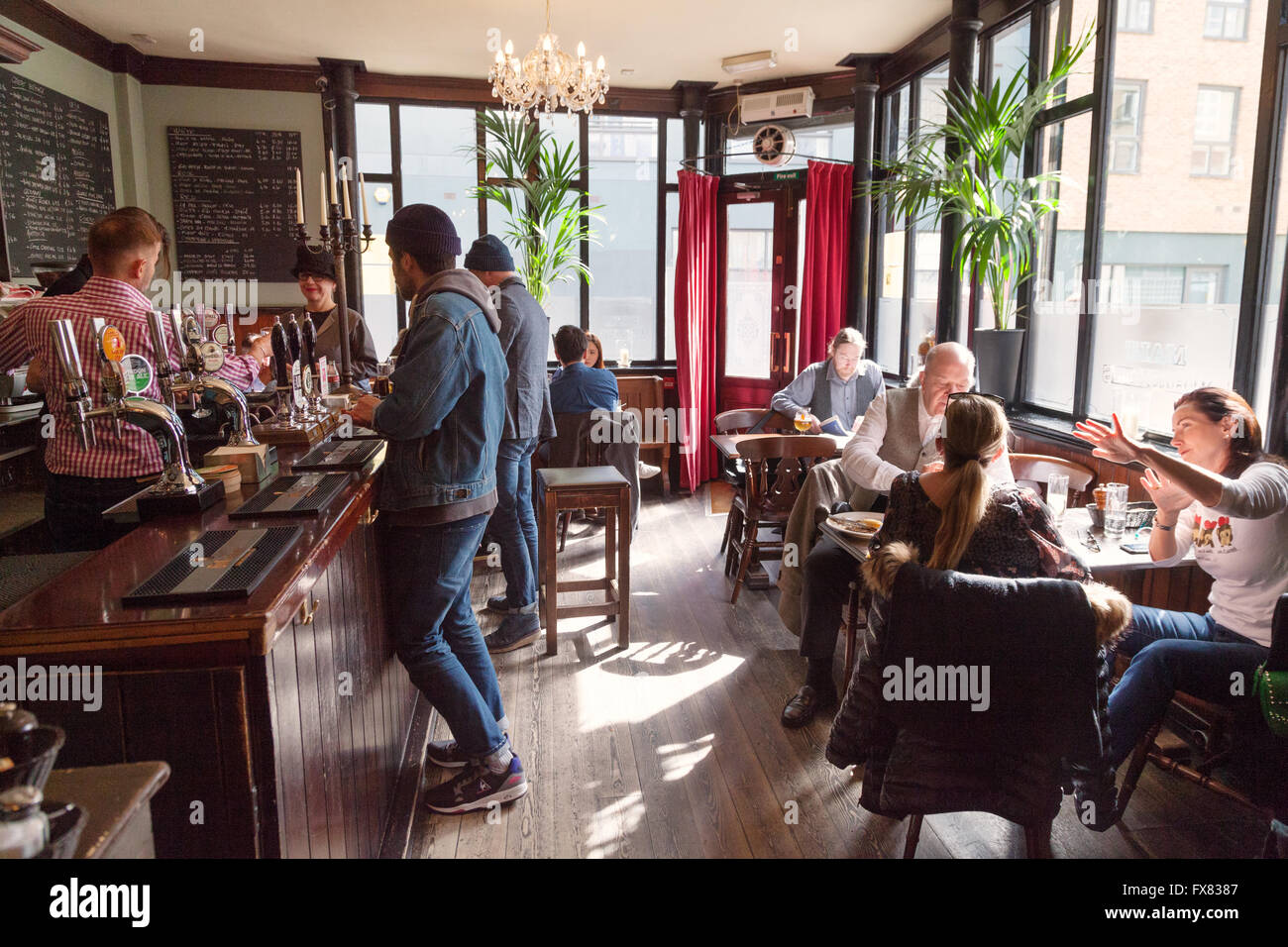People drinking in the Carpenters Arms pub, Cheshire Street, Spitalfields, East End London UK (See also image FXD2YY) - Stock Image
