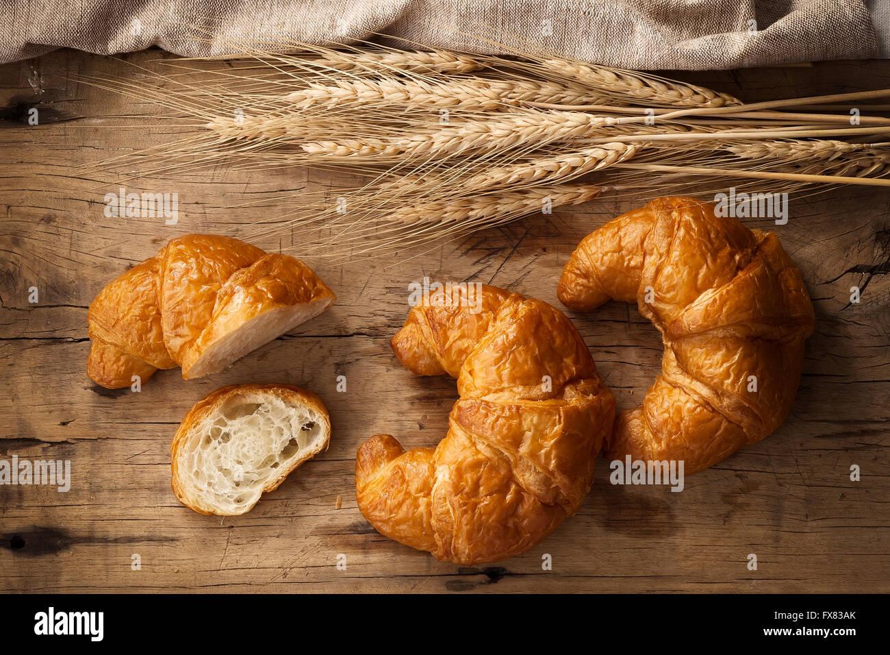 Tasty croissant still life rustic wooden background bakery breakfast brunch - Stock Image