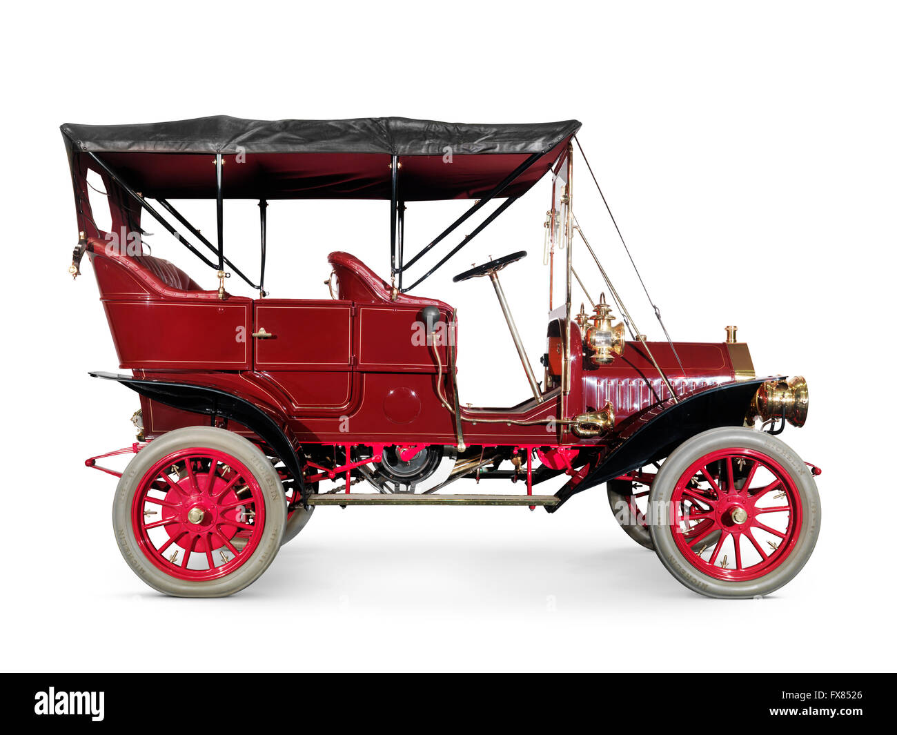 Red 1908 McLaughlin-Buick Model F antique vintage retro car side view isolated on white background with clipping - Stock Image