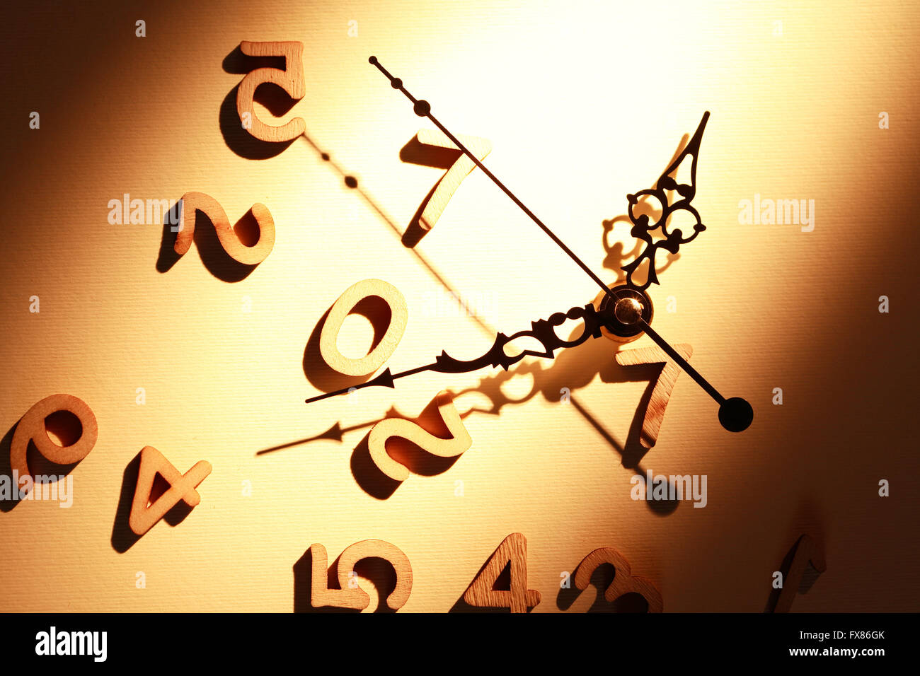 Time concept. Clock face near set of wooden digits - Stock Image