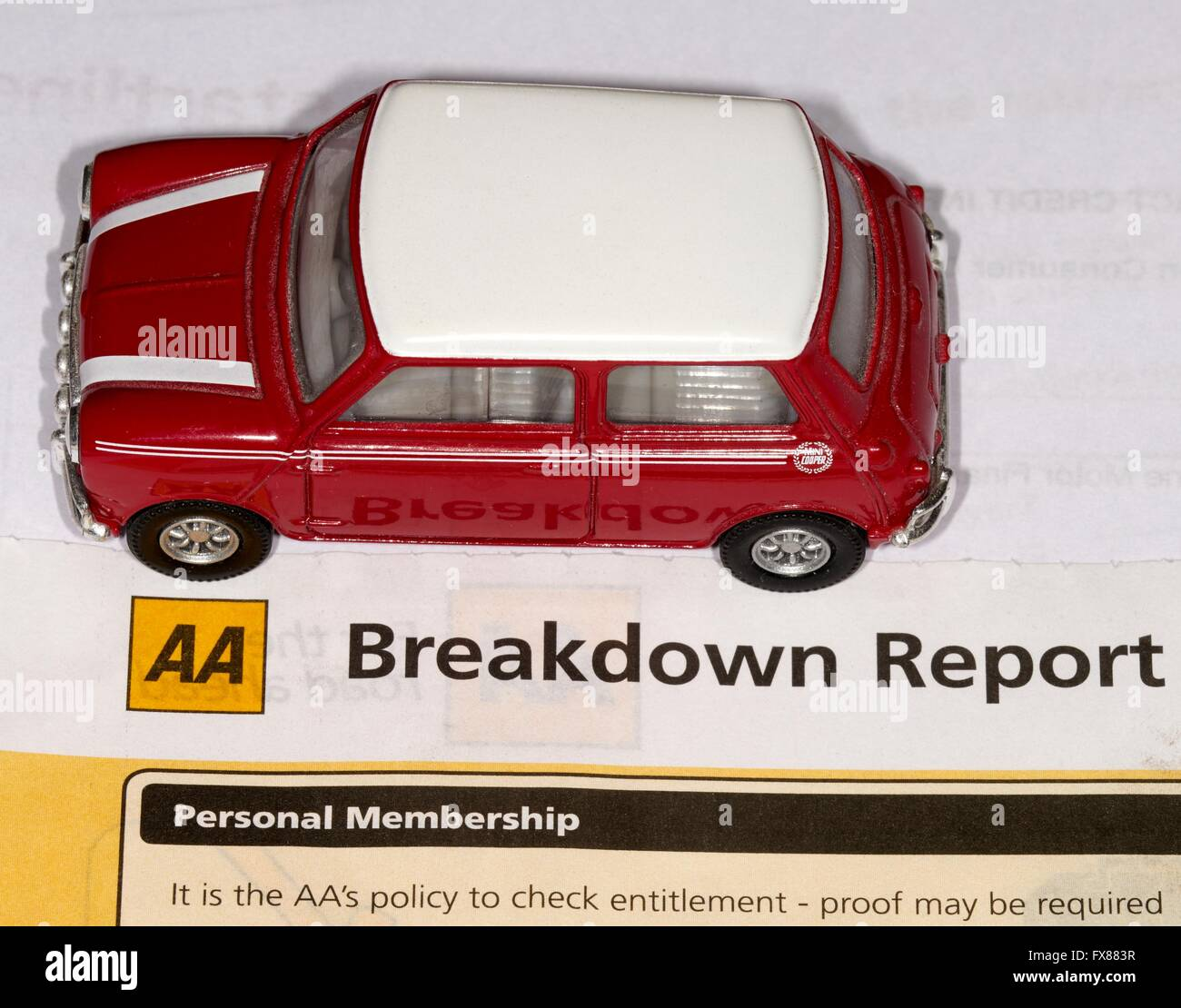 A miniature red mini cooper in front of a AA  breakdown report Stock Photo