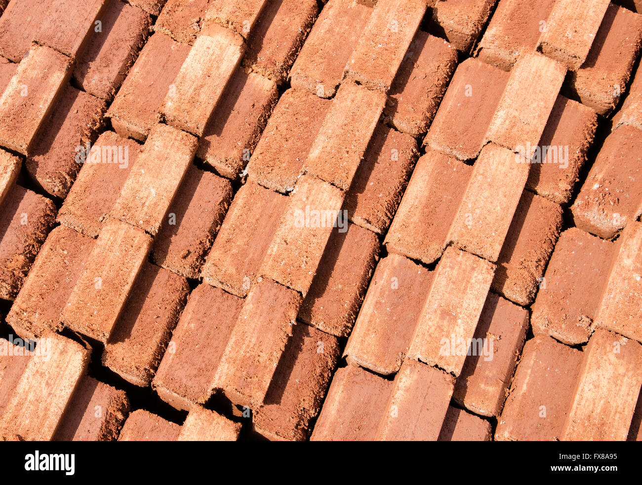 Interlocking bricks made by compressing earth and cement in a brick mold - Kenya East Africa - Stock Image