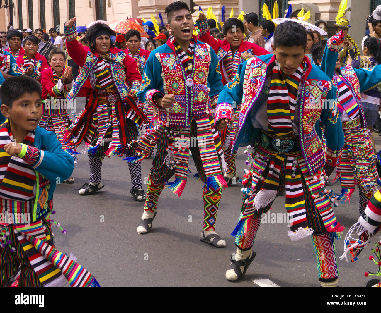 people in traditional peruvian dress dancing in the street in lima