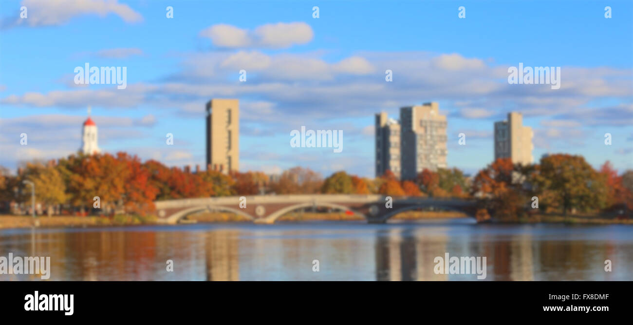 Blurred background of Weeks Bridge and dorm towers of Harvard University across the Charles in Cambridge, MA, USA. - Stock Image