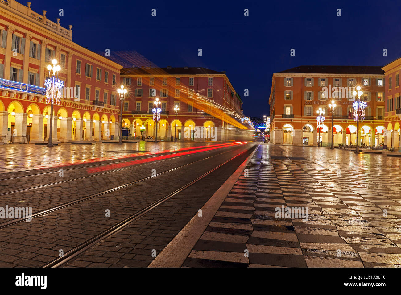 Nice, Place Massena,- Showing the square with tram lines and chequered  paving, early morning, France Stock Photo