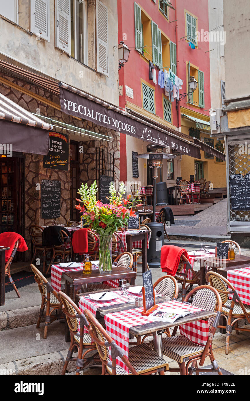 Nice Old town, Vieille Ville - Showing cafe tables and chairs in the street - Cote d'Azur, Provence, France - Stock Image