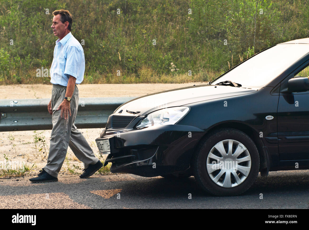 broken car and driver. - Stock Image
