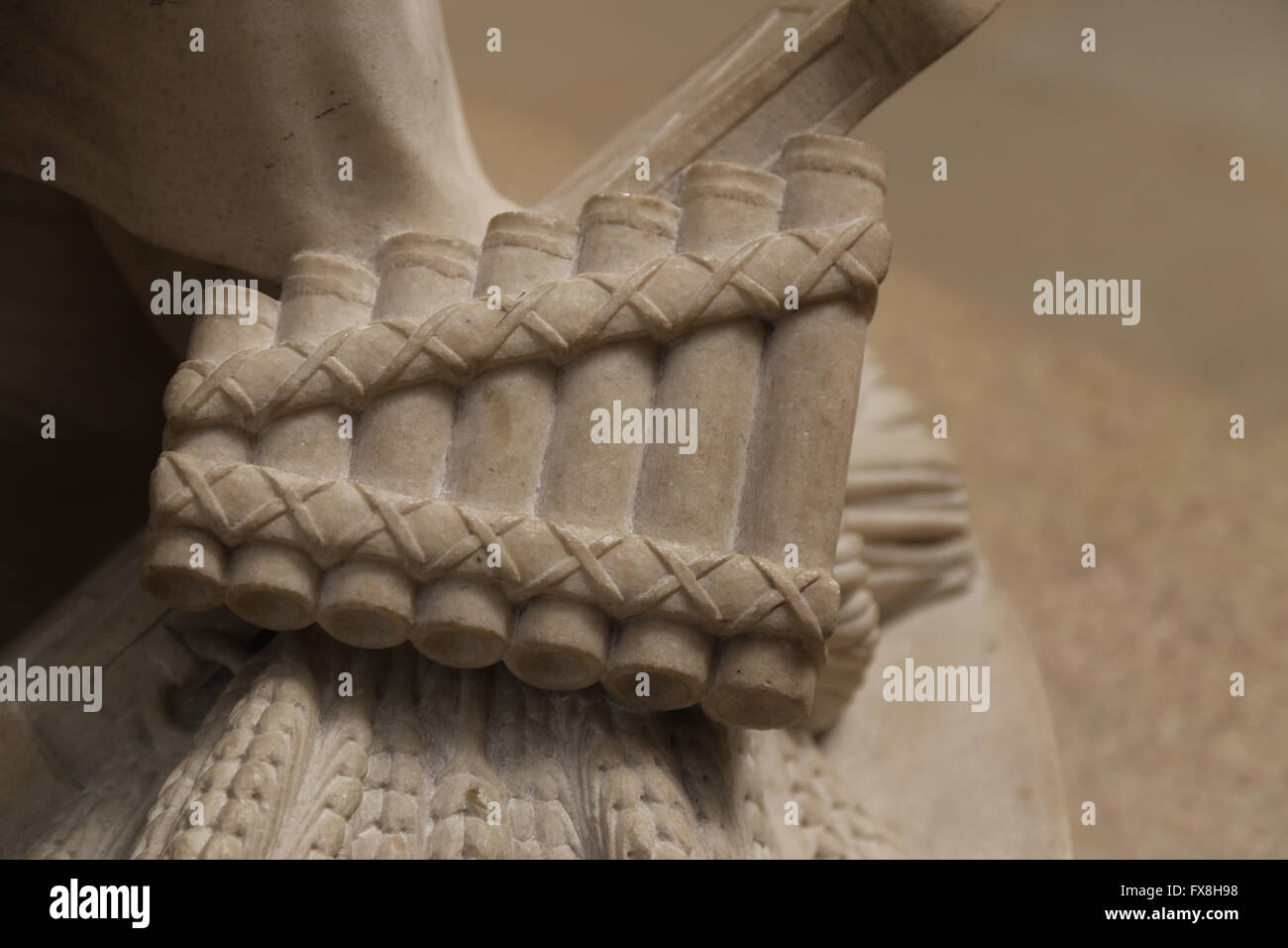 Classical times. Pan flute, musical instrument. Detail. Statue. Orsay Museum. France. - Stock Image