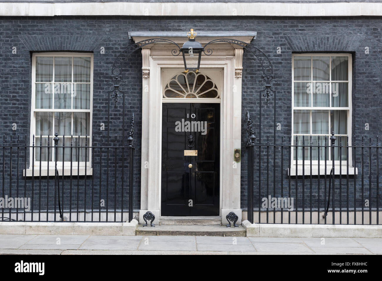 The closed front door of Number 10 Downing Street, London, England. This is the official residence of the British - Stock Image