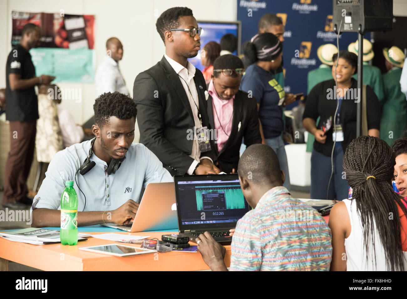 Young Nigerian people using technology at Social Media Week business conference in Lagos Nigeria - Stock Image