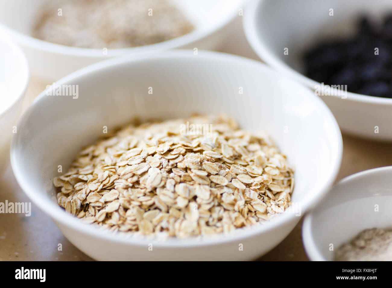 Rolled oats in a plate on a table Stock Photo