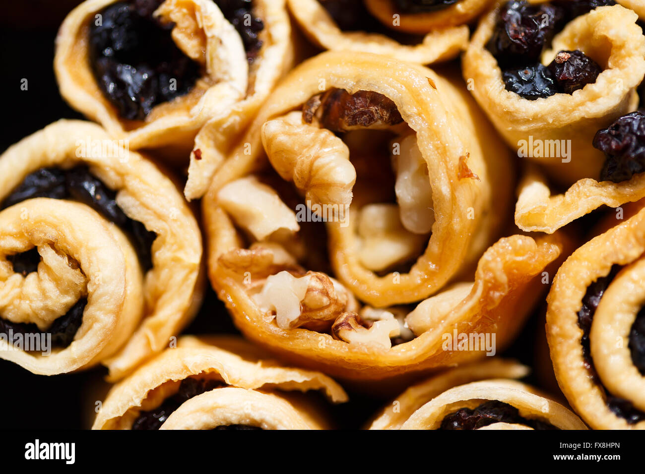 Dietary sweets with nuts and raisins close up - Stock Image