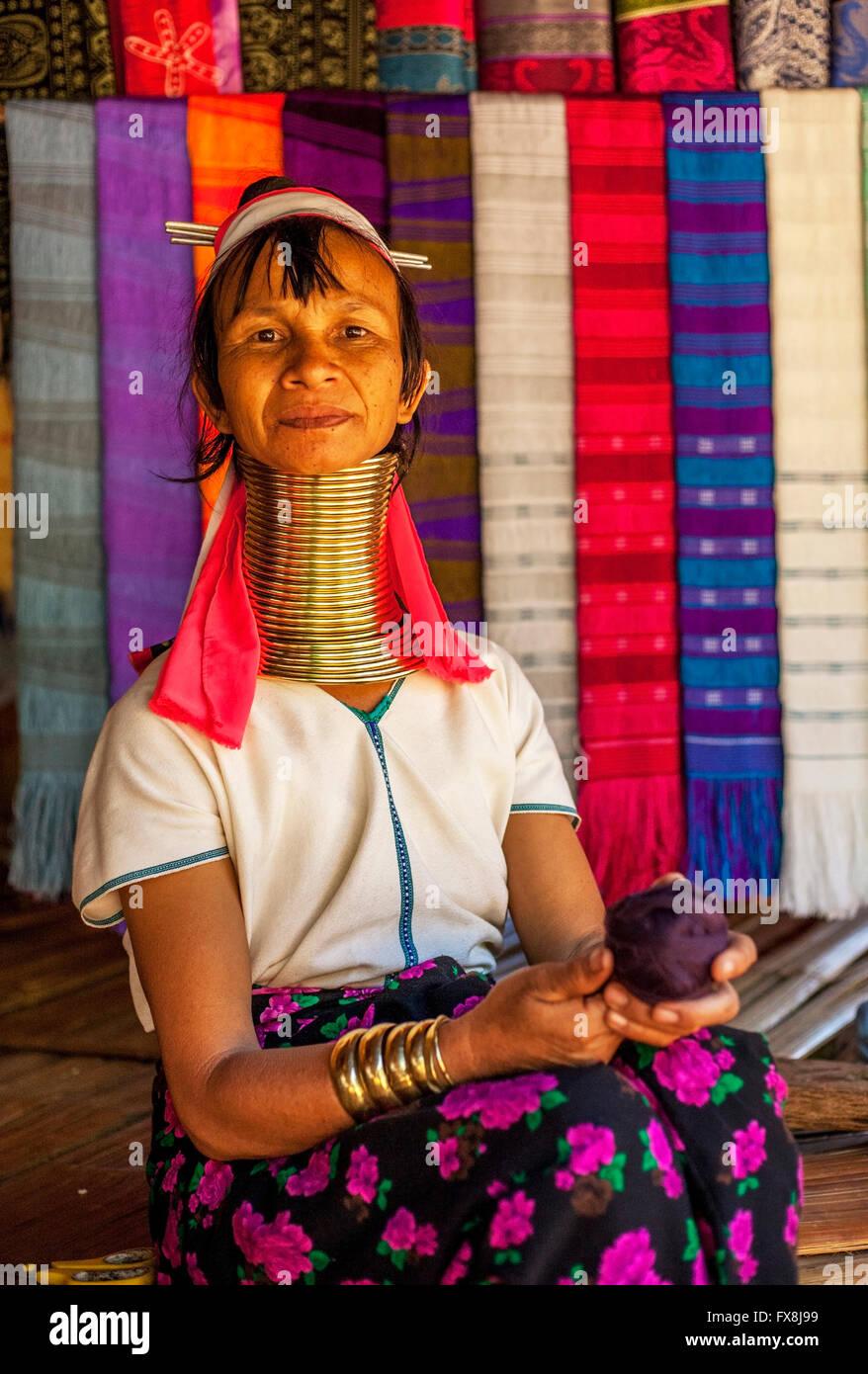 Kayan Lahwi Neck Ring Padaung  Woman sitting at stall Stock Photo