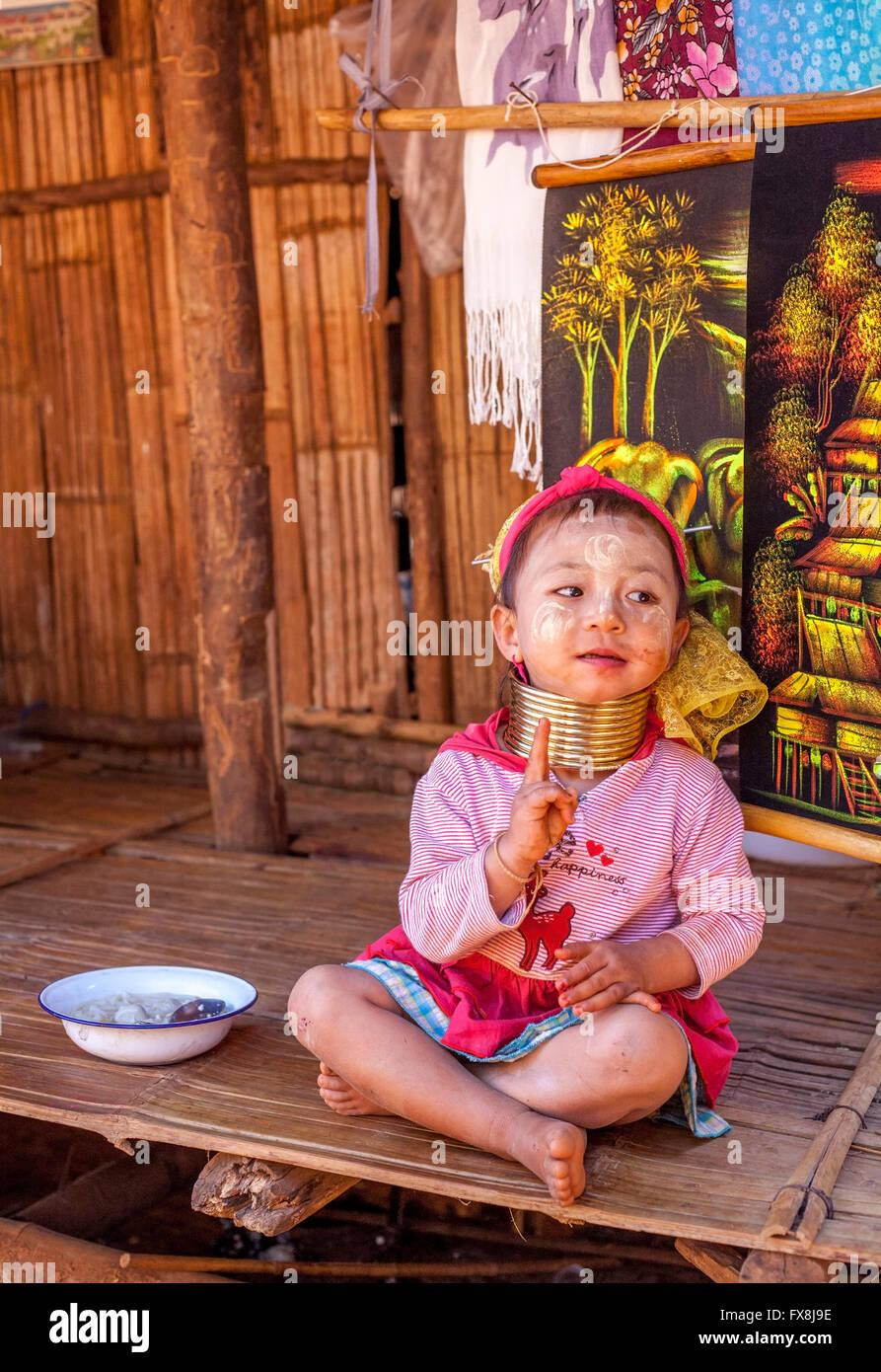 Smiling young Padaung child wearing a Kayan Lahwi Neck ring Thailand Stock Photo