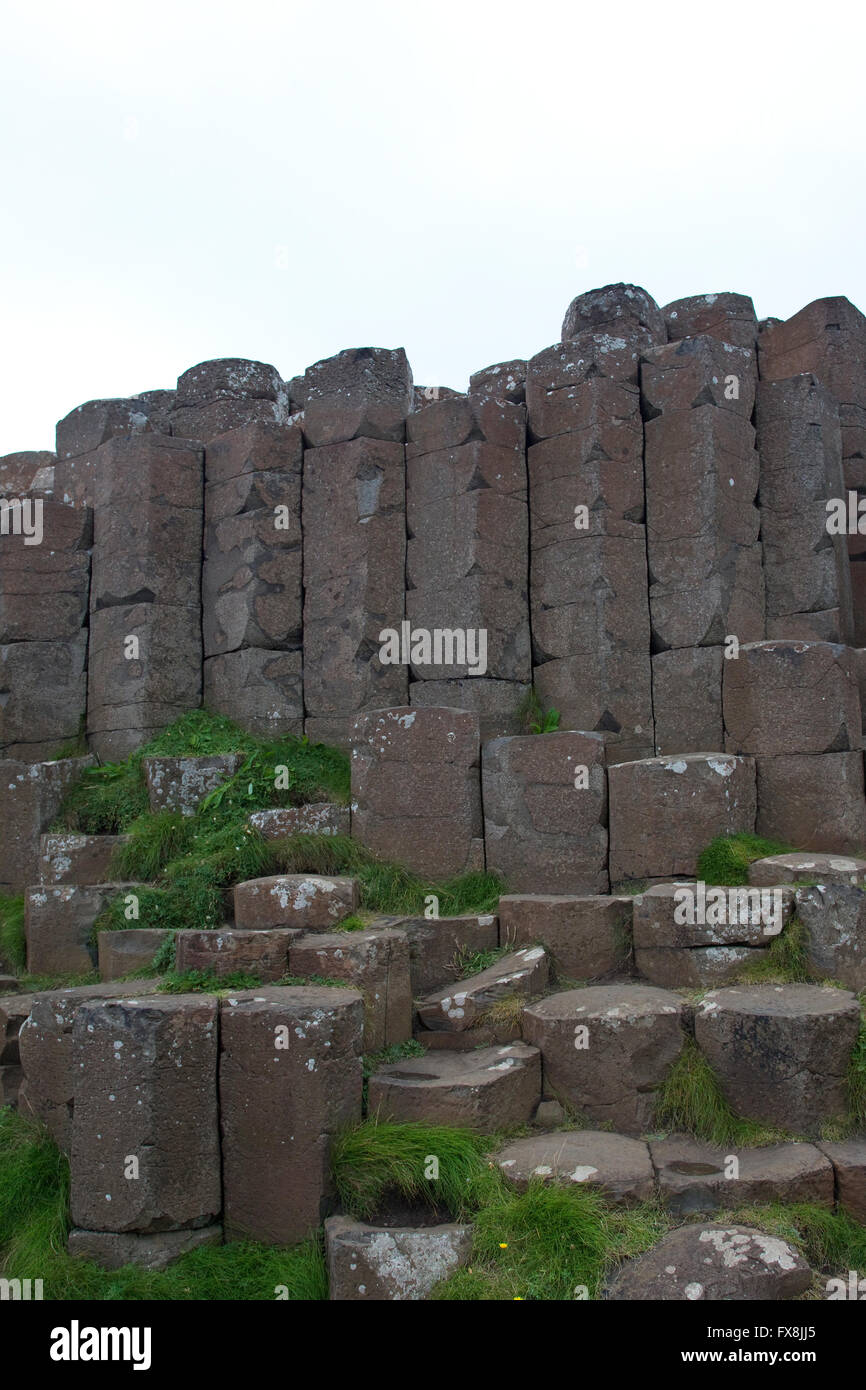View of interlocking basalt columns on the Giant's Causeway formed as a result of volcanic activity in County - Stock Image