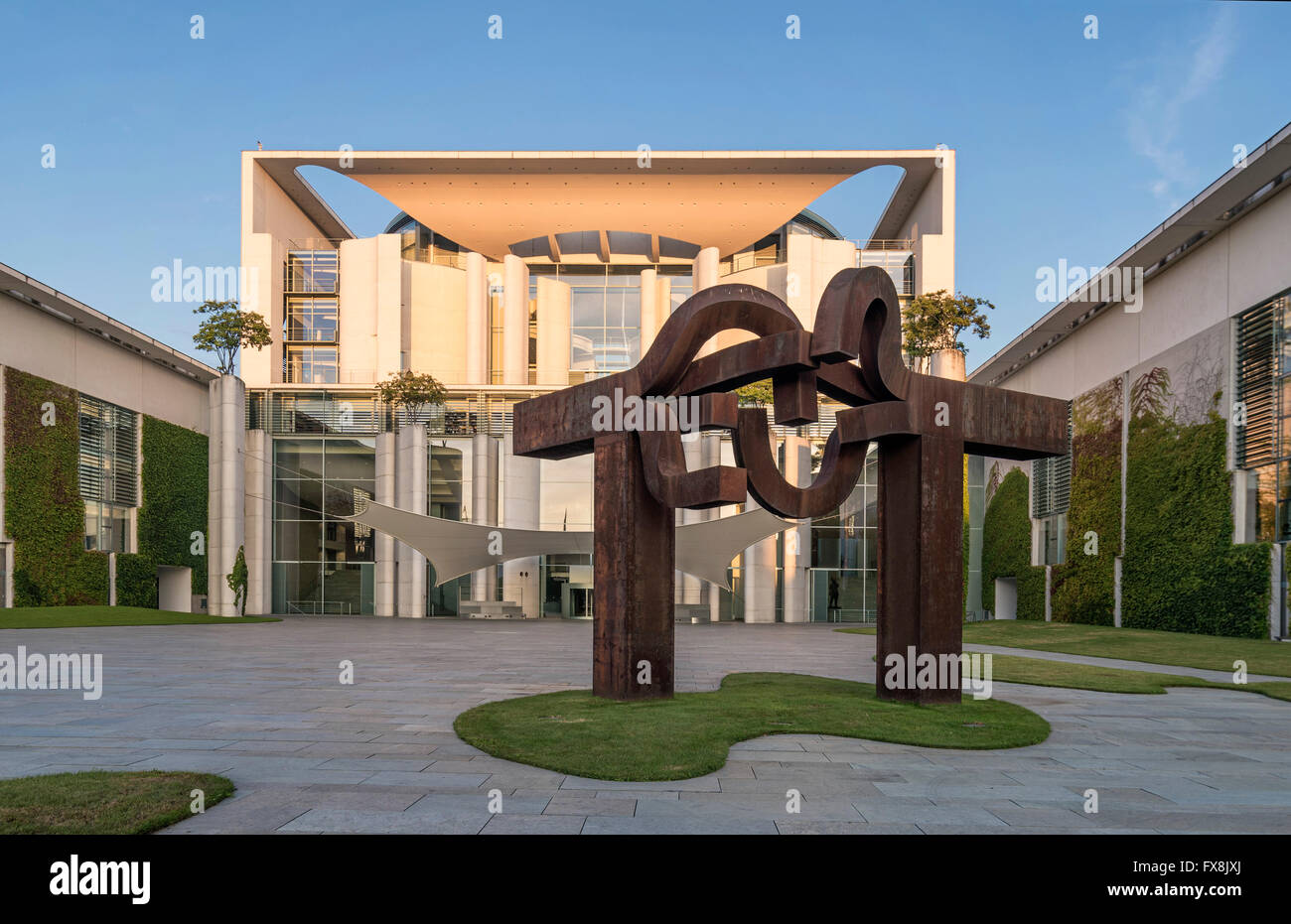 "Sunrise at german federal chancellery, Bundeskanzleramt, steel sculpture ""Berlin"" by Basque artist Eduardo Chillida, Stock Photo"