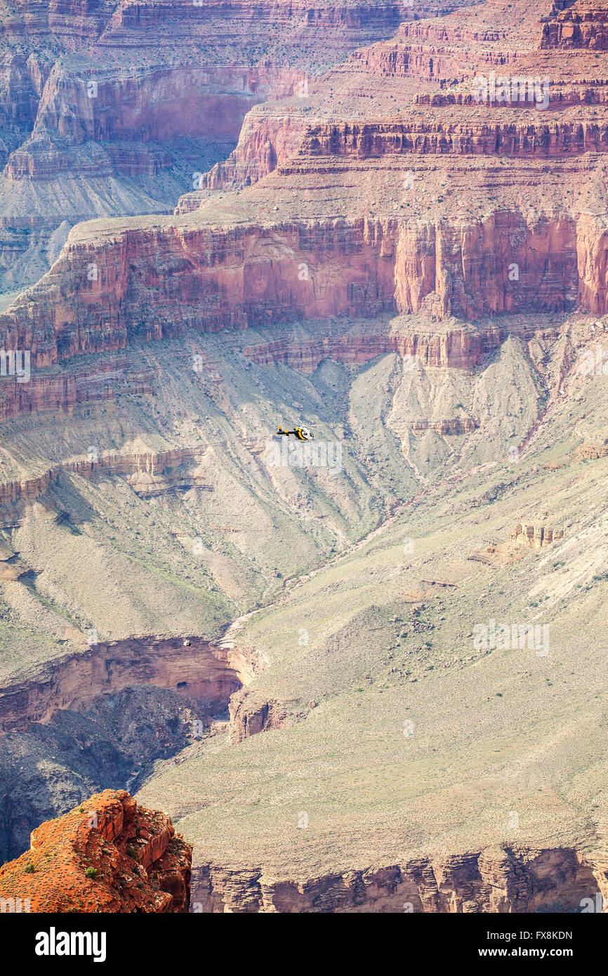 Helicopter carrying load over Grand Canyon, Arizona, USA. - Stock Image