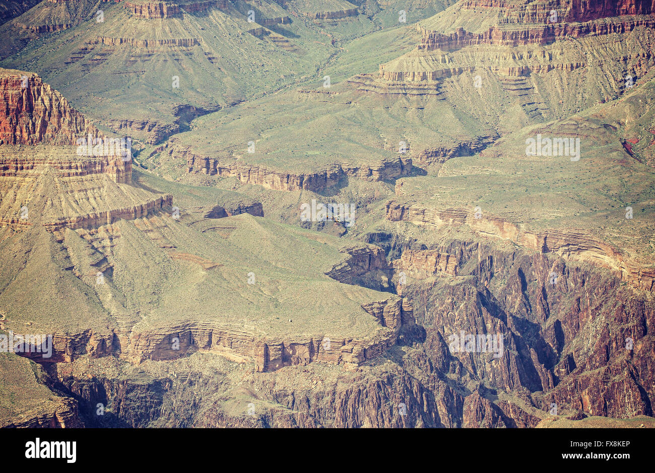 Vintage toned photo of a helicopter carrying load over Grand Canyon, Arizona, USA. - Stock Image