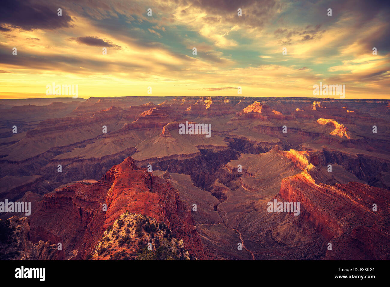 Vintage toned sunset over Grand Canyon, one of the top tourist destinations in the United States. - Stock Image