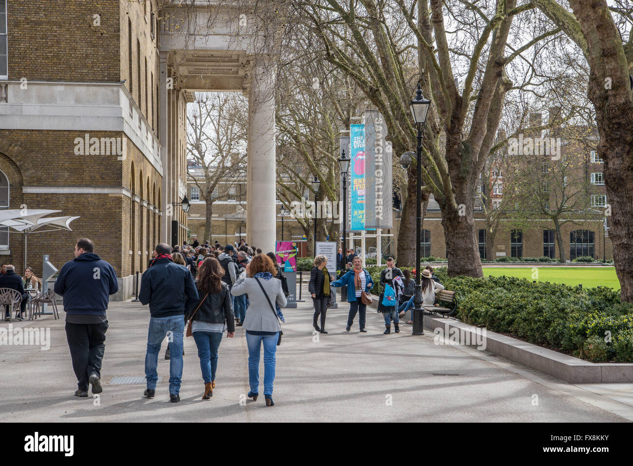 People making their way into the Rolling Stone exhibition at the Saatchi Gallery in Kings Road, Chelsea, London. - Stock Image