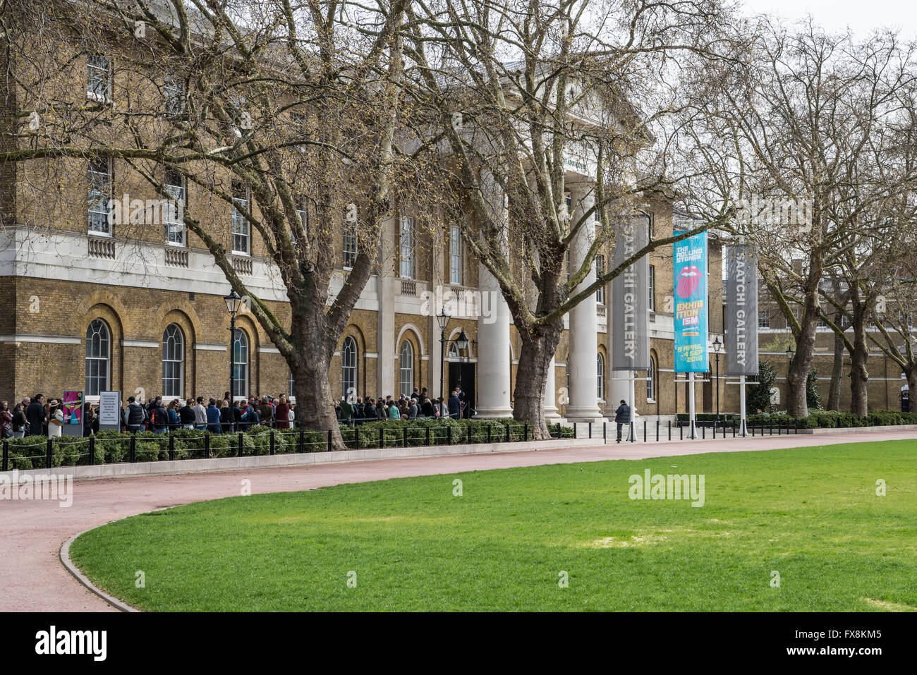 Visitors entering the Rolling Stones exhibition at the Saatchi Gallery, London - Stock Image
