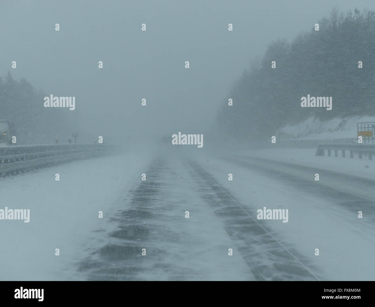 Highway in winter, slippery, dangerous driving conditions - Stock Image
