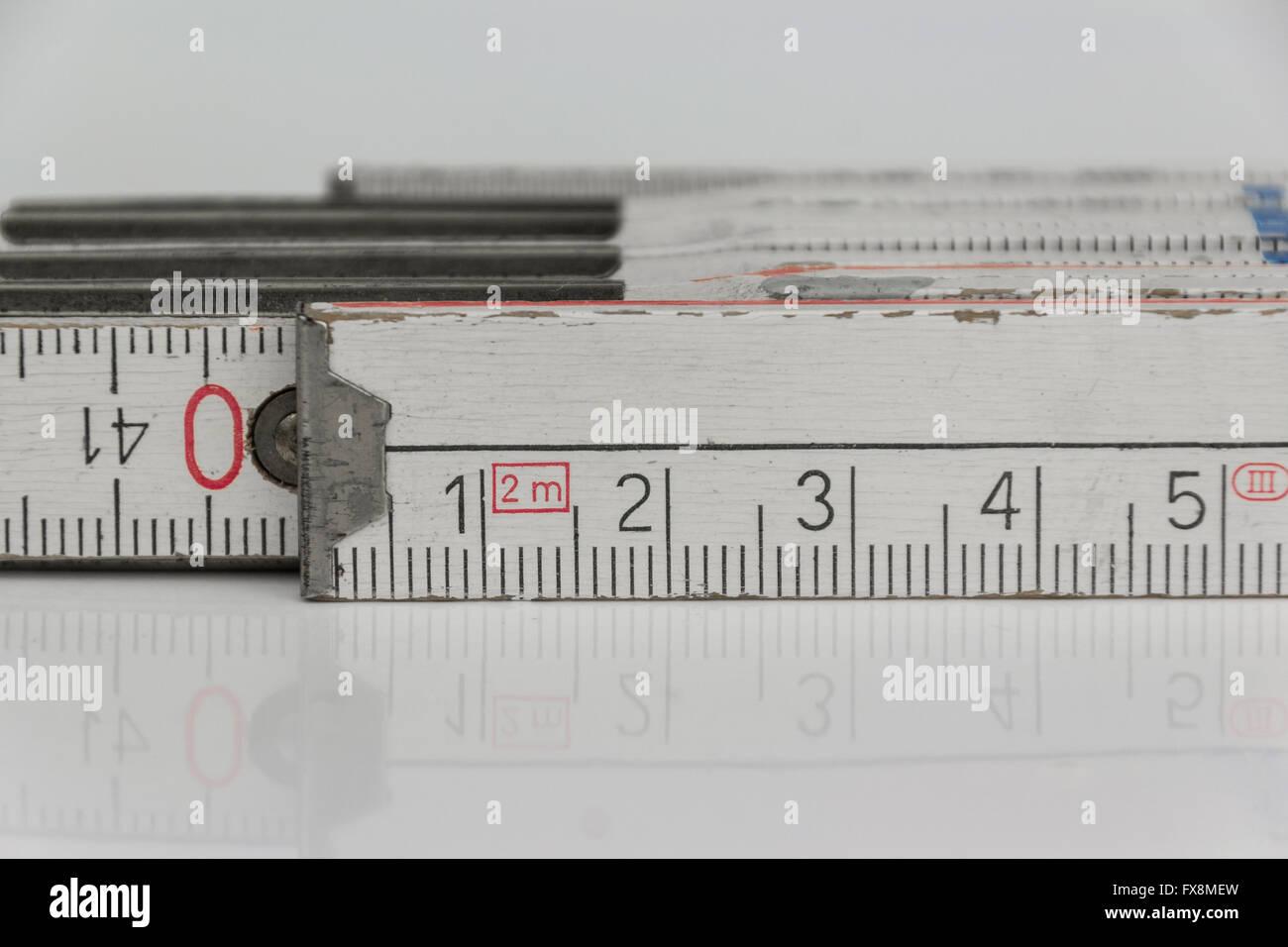folding rule macro - closeup of metric folding ruler - Stock Image