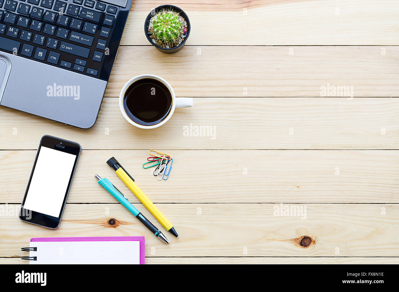 Office Desk Table With Laptop Smartphone Coffee Cup Pen