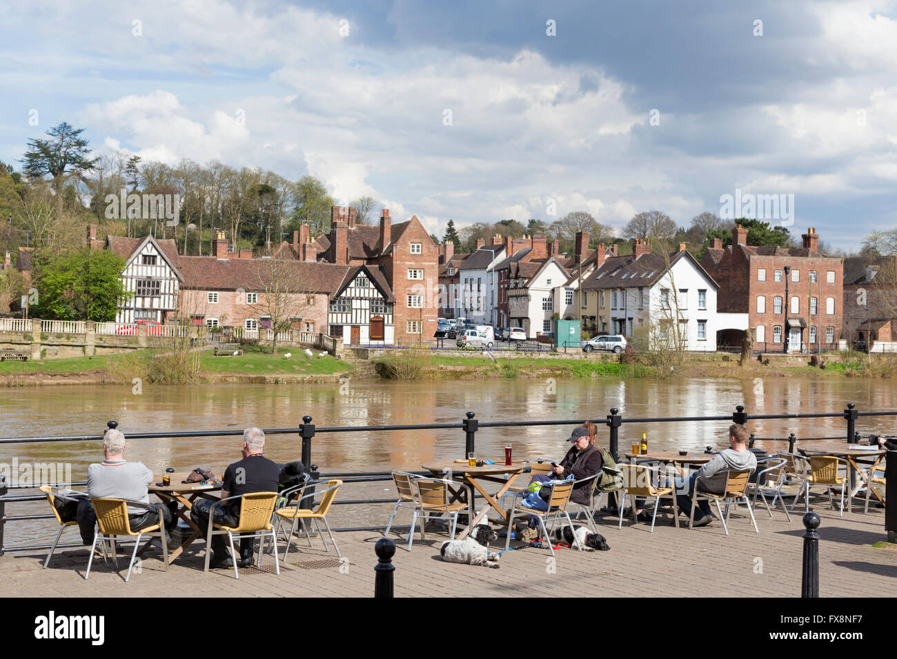 Relaxing by the River Severn in the riverside town of Bewdley, Worcestershire, England, UK - Stock Image