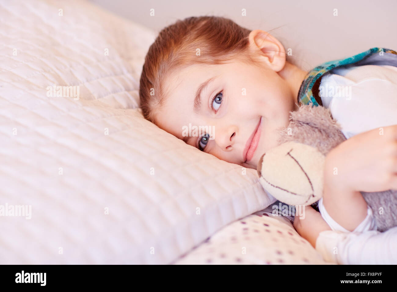 If I sleep, teddy sleeps too - Stock Image