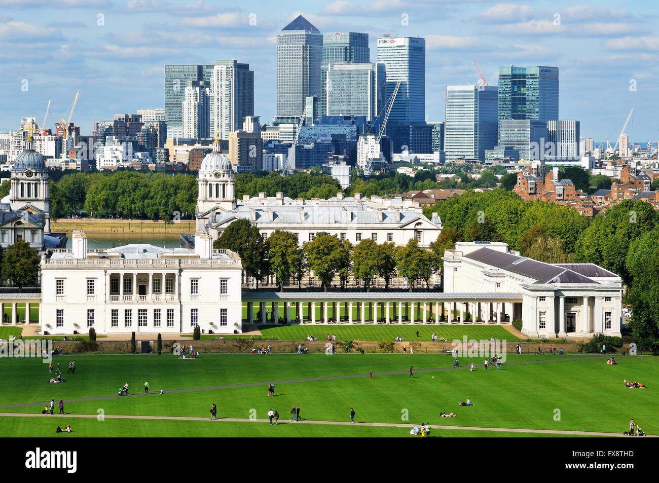 Canary Wharf fom Greenwich Park, London UK, with Royal Naval College buildings - Stock Image