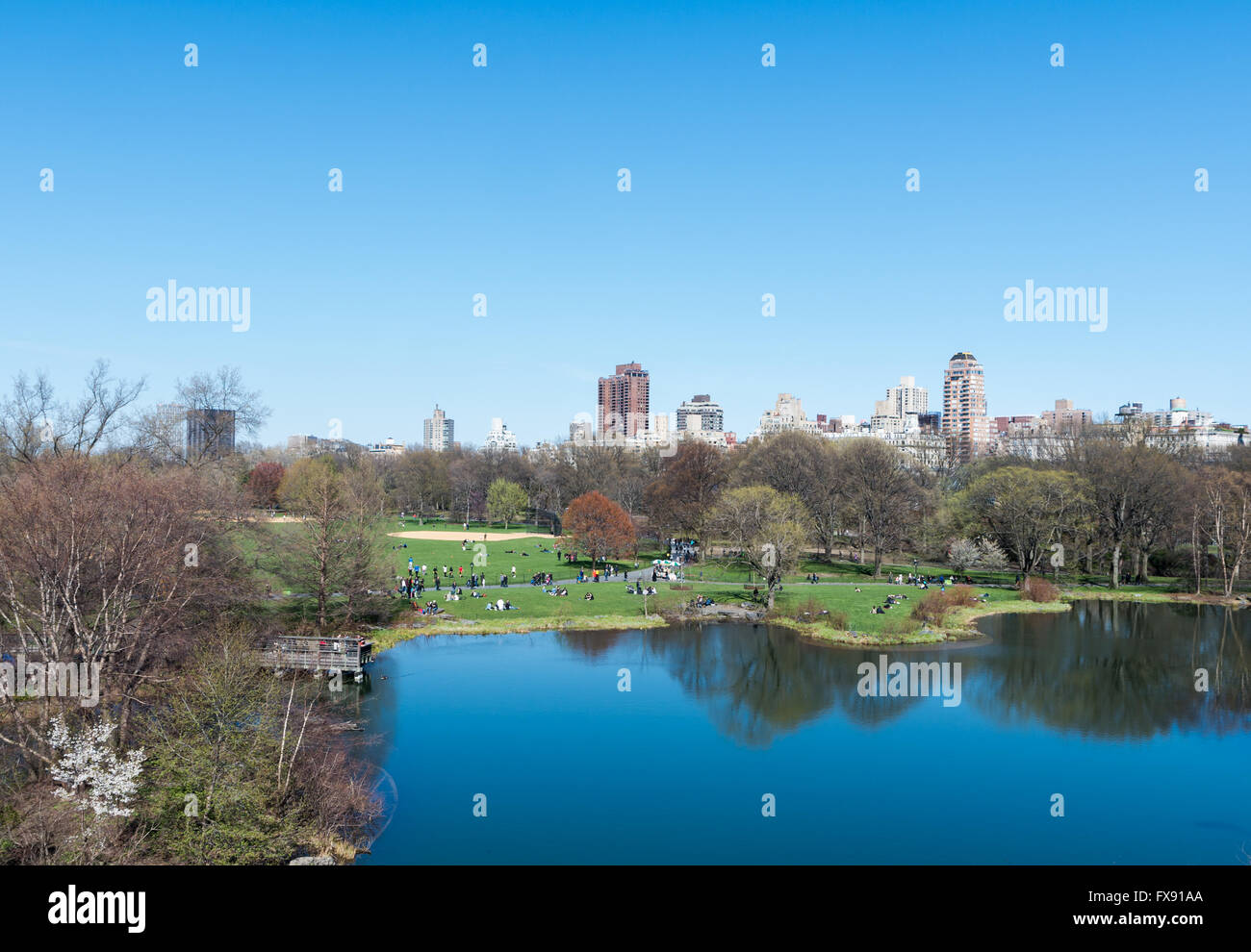 View from Belvedere Castle overlooking Turtle Pond and the Great Lawn, towards the Upper East Side of Manhattan, - Stock Image