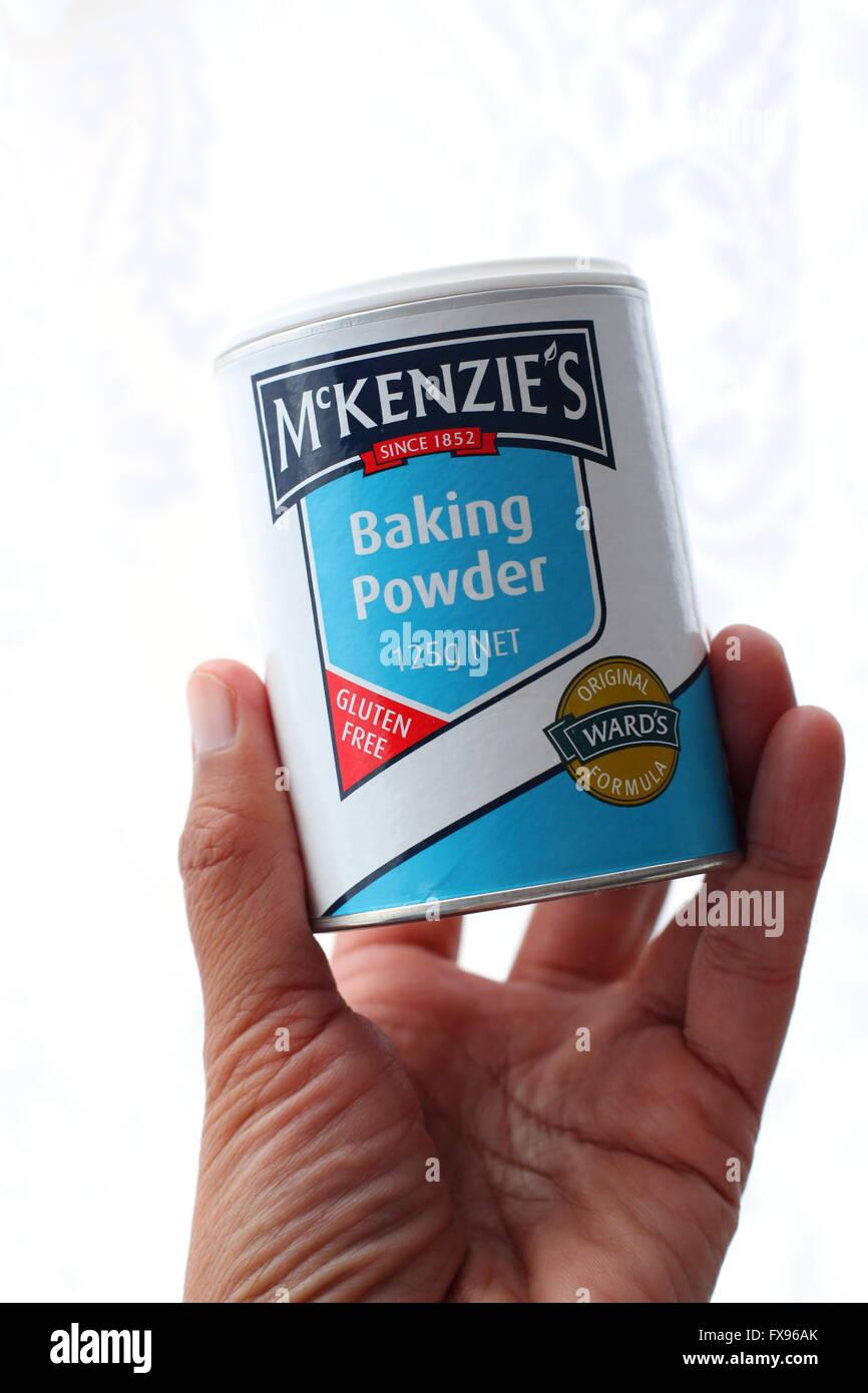 Close up image of left hand holding McKenzie's Baking Powder