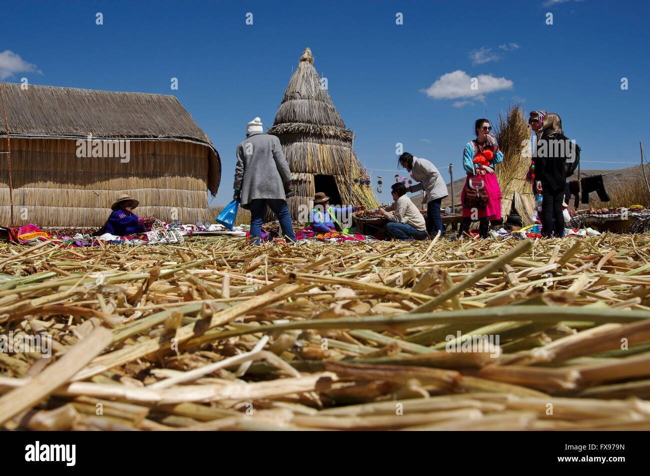 Women of the Uros people selling souveniers on their reed island in Lake Titicaca to tourists. Picture taken 2015 - Stock Image