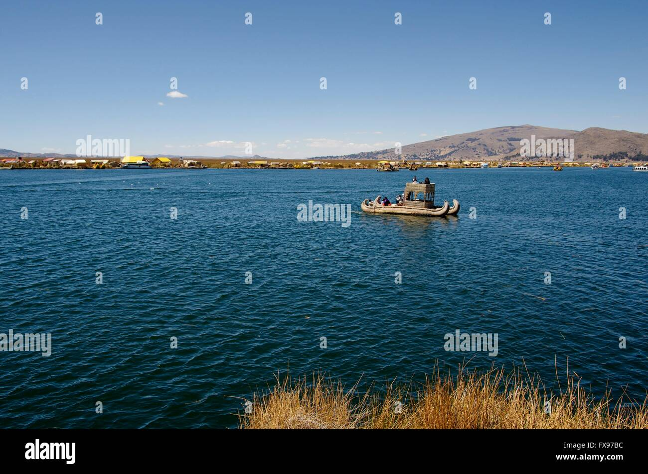 Reed boats as a tourist attraction on Lake Titicaca. Nowadays tourism is an important source of income for the Uros - Stock Image