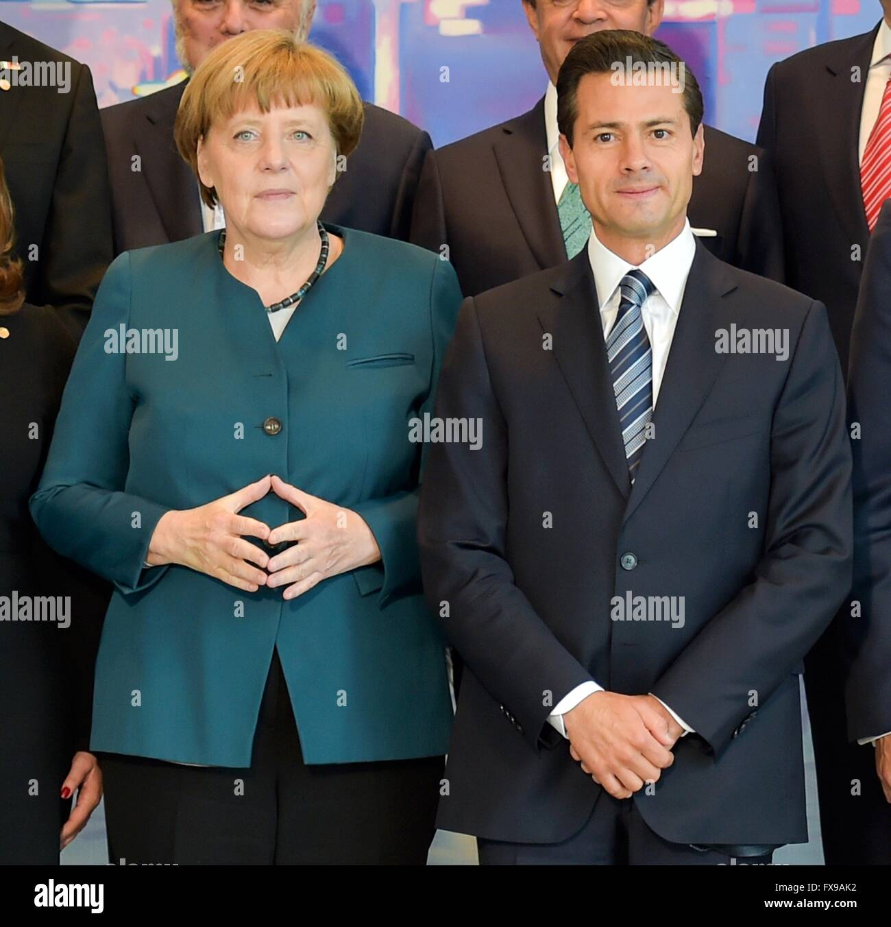 German Chancellor Angela Merkel stands with Mexican President Enrique Pena Nieto for a group photo following expanded - Stock Image