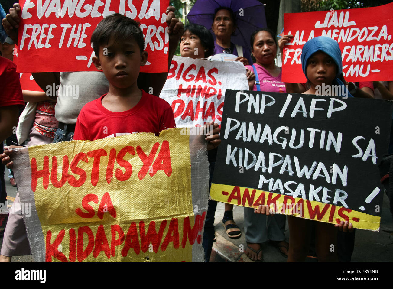 Philippines. 13th Apr, 2016. Young kids join the protest in front of the Department of Justice in Manila. Protesters Stock Photo