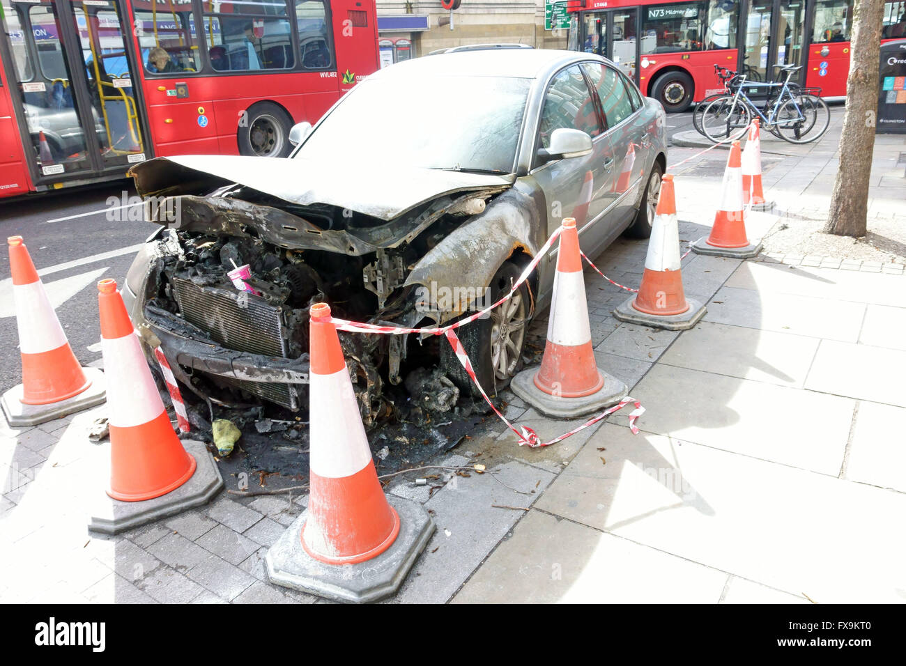 Burned out car on roadside is Islington, London Stock Photo