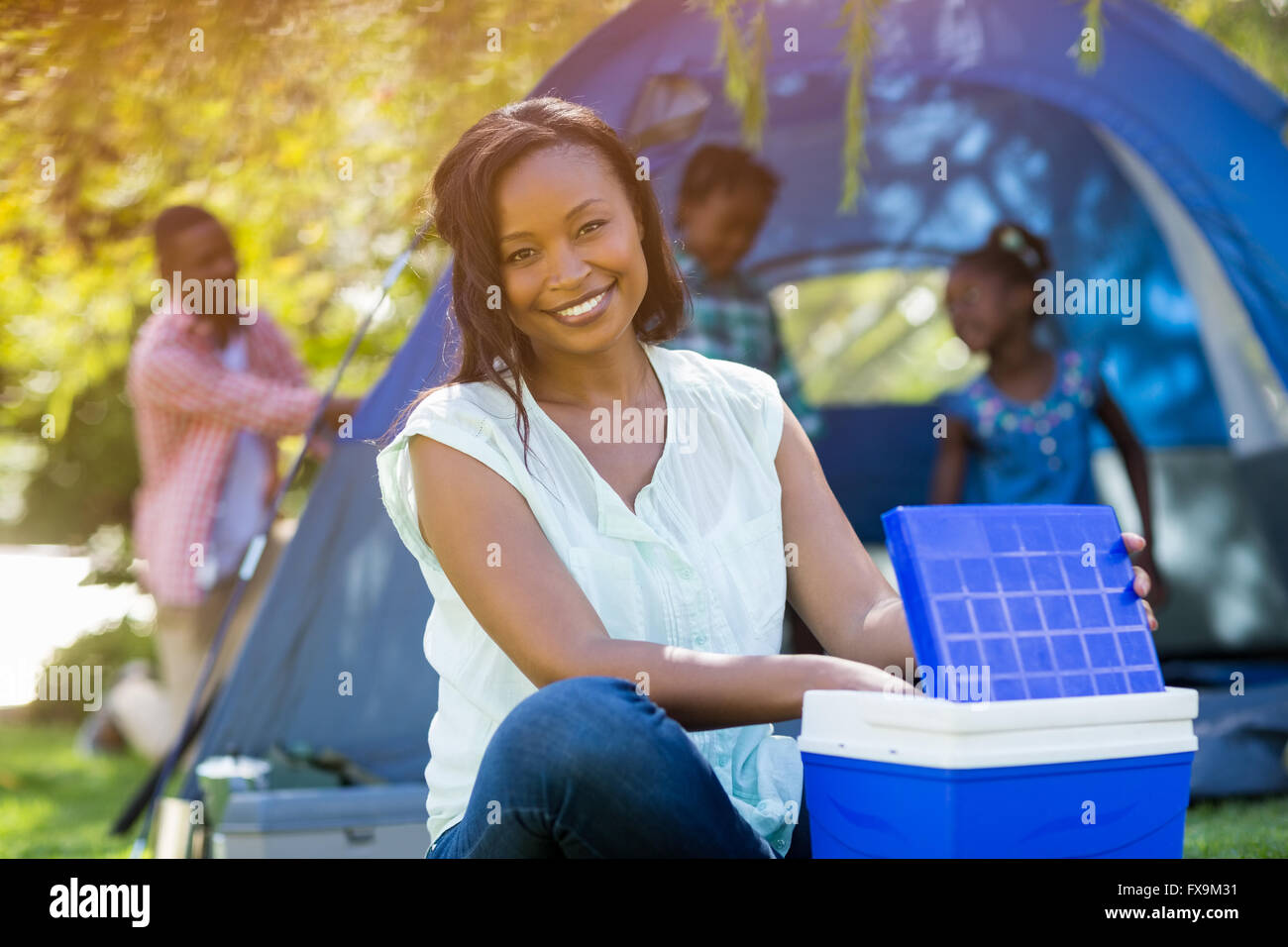 Happy woman posing and using a cooler - Stock Image