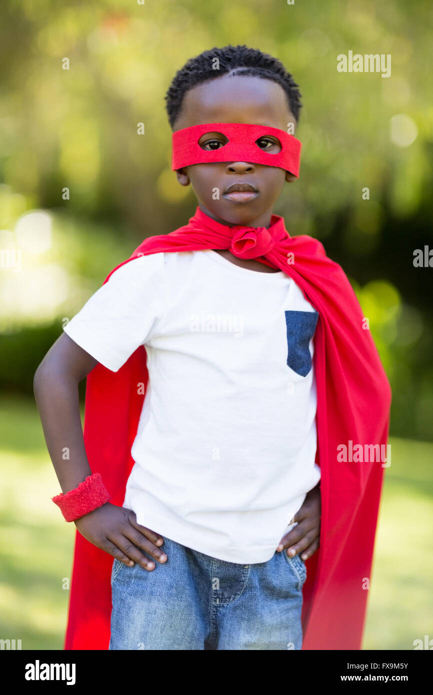 Young child dressing up as a hero - Stock Image