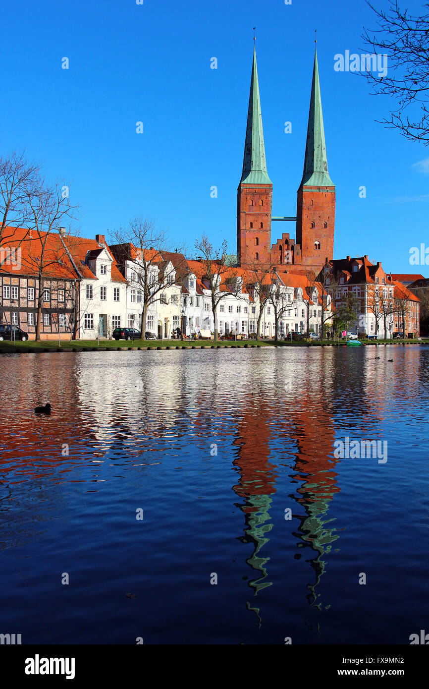 Lubeck old town with Lubeck Cathedral (Lubecker Dom) reflected in Trave river, Germany - Stock Image