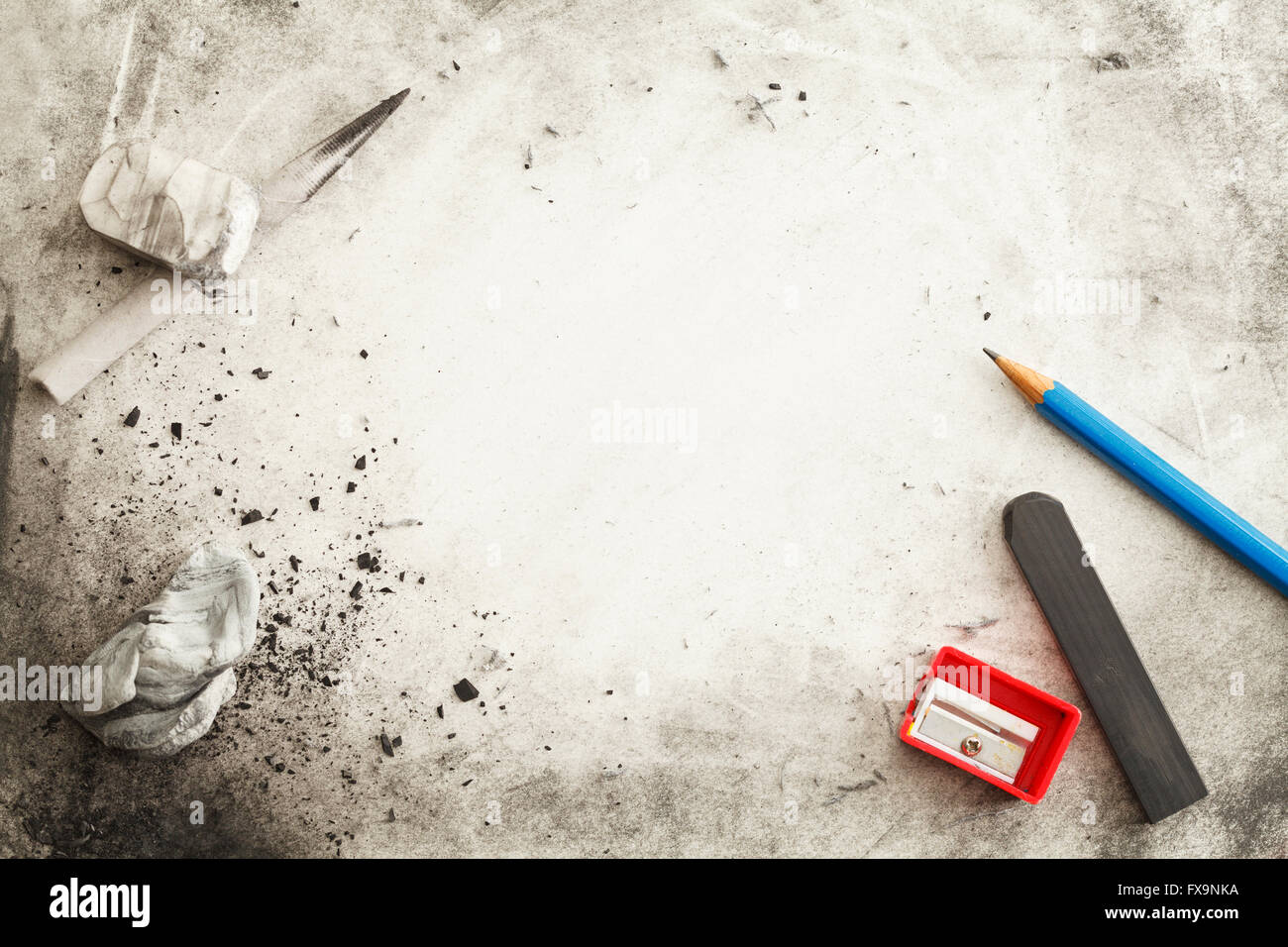 Paper with Pencil, Eraser, Charcoal, Smudges, Messy Marks and Copy Space. - Stock Image