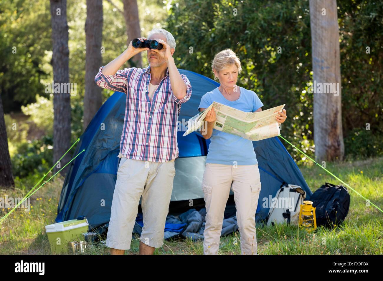 Mature couple preparing hike - Stock Image