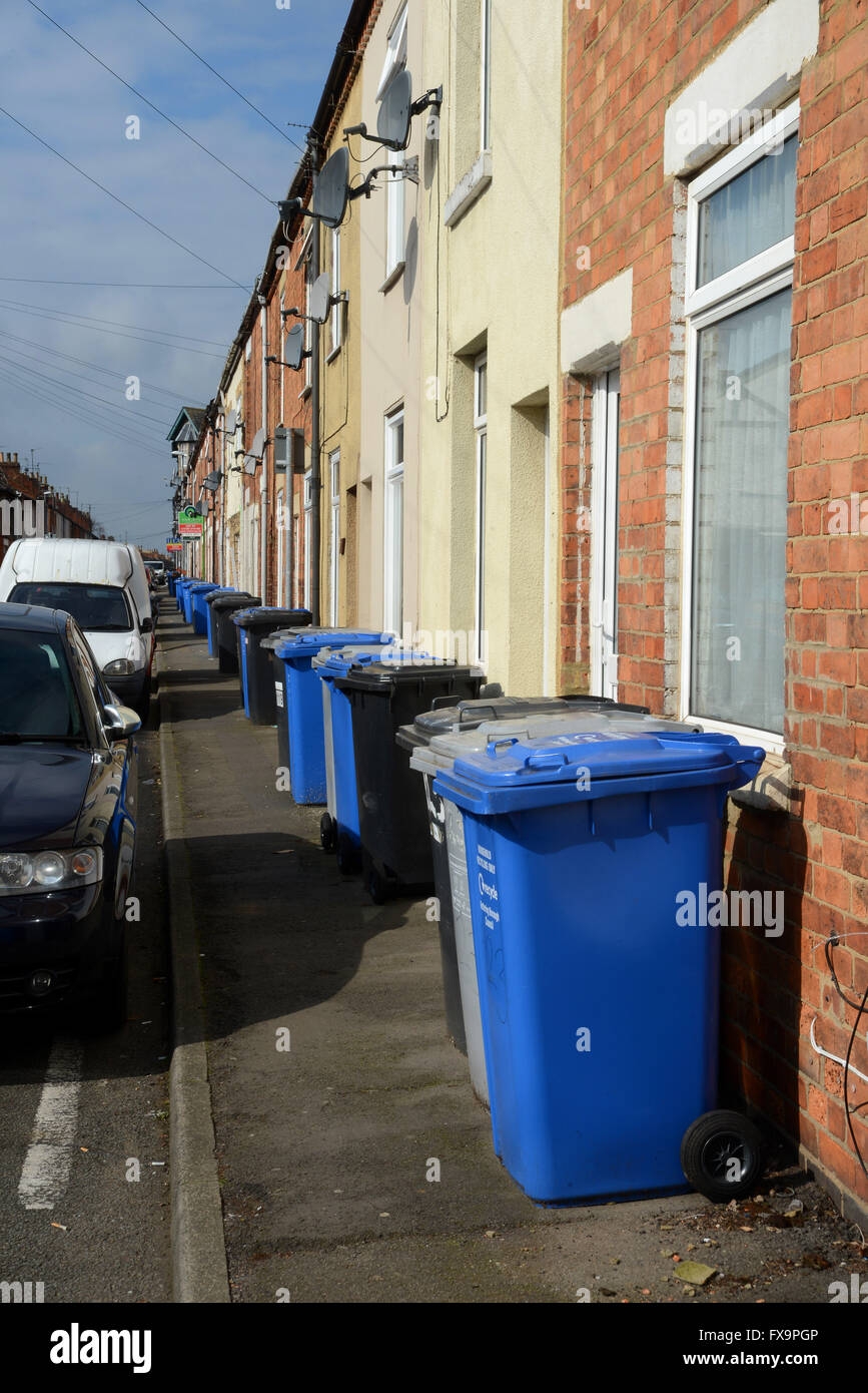 Household waste collection bins are a permanent sight on the footpath in Havelock  Road, Kettering, Northamptonshire. - Stock Image