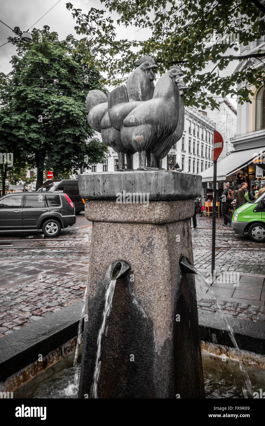 Fountain with sculpture of chickens - Stock Image