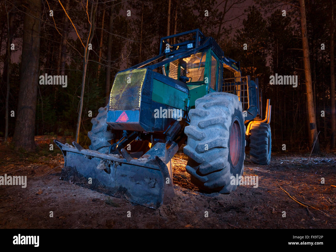 A forestry forwarder truck light painted during a long exposure at night. East Gwillimbury, Ontario, Canada. Stock Photo