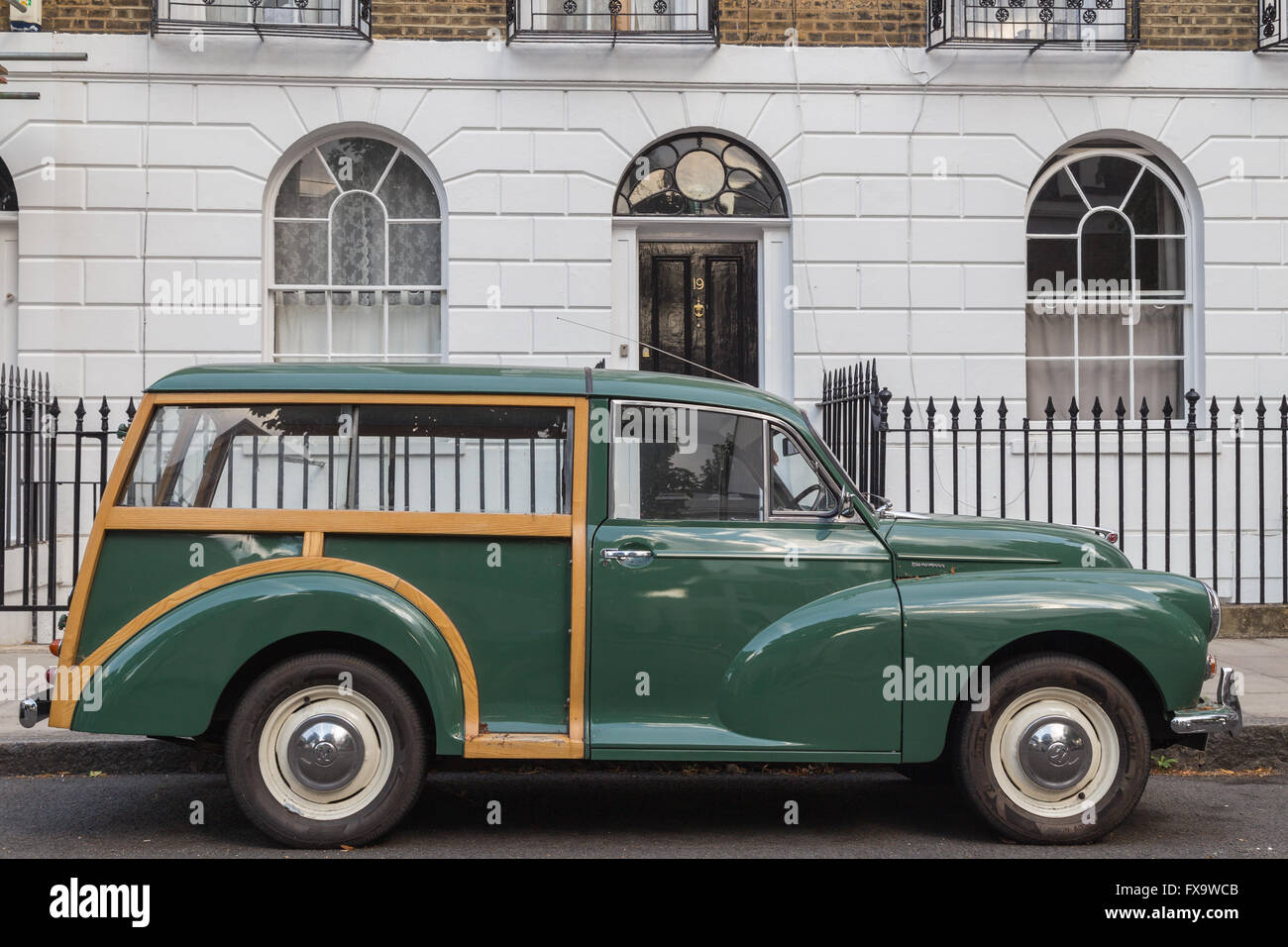 vintage Morris Traveller car outside a Georgian terrace in Islington, London N1 - Stock Image